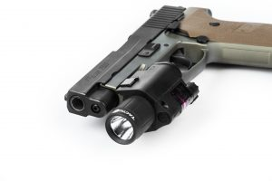 Tacticon Laser flashlight affixed to hand gun Sig P220