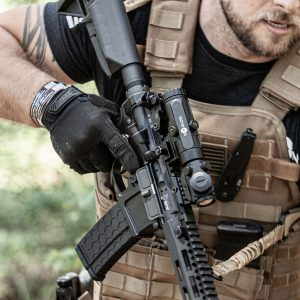 Adult Male with Falcon V1 3X Flip-To-Side Magnifier Red Dot Sight Mounted on AR 15