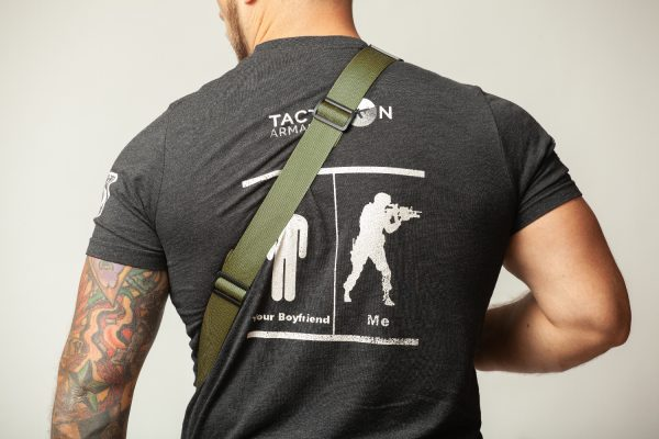 Green rifle sling on back