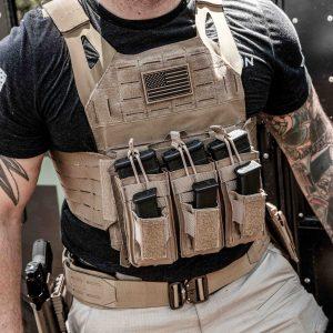 Adult male wearing FDE Tan BattleVest Lite lightweight plate carrier vest with K3 Battle Pouch